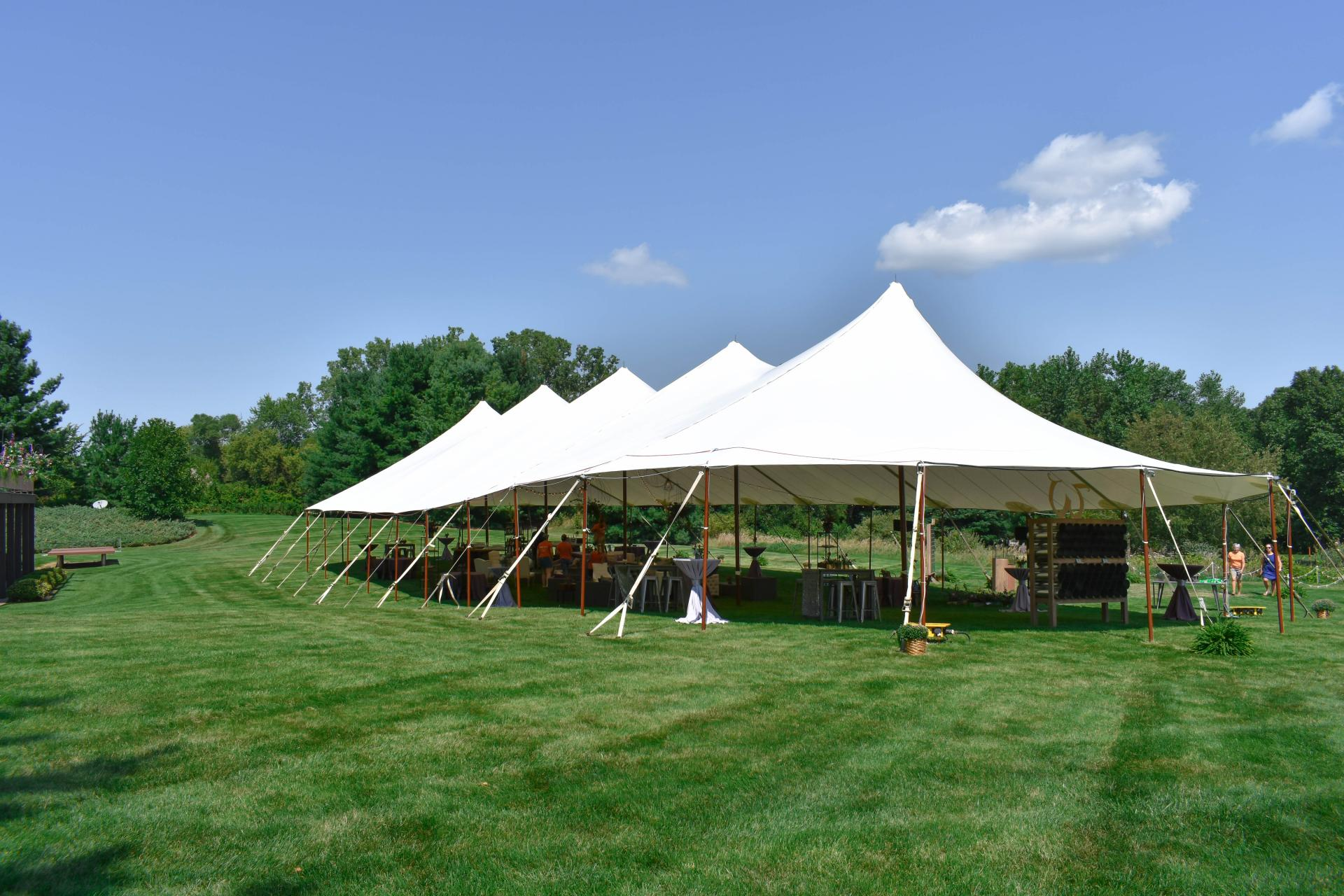 sailcloth tent set for cocktails at a wedding