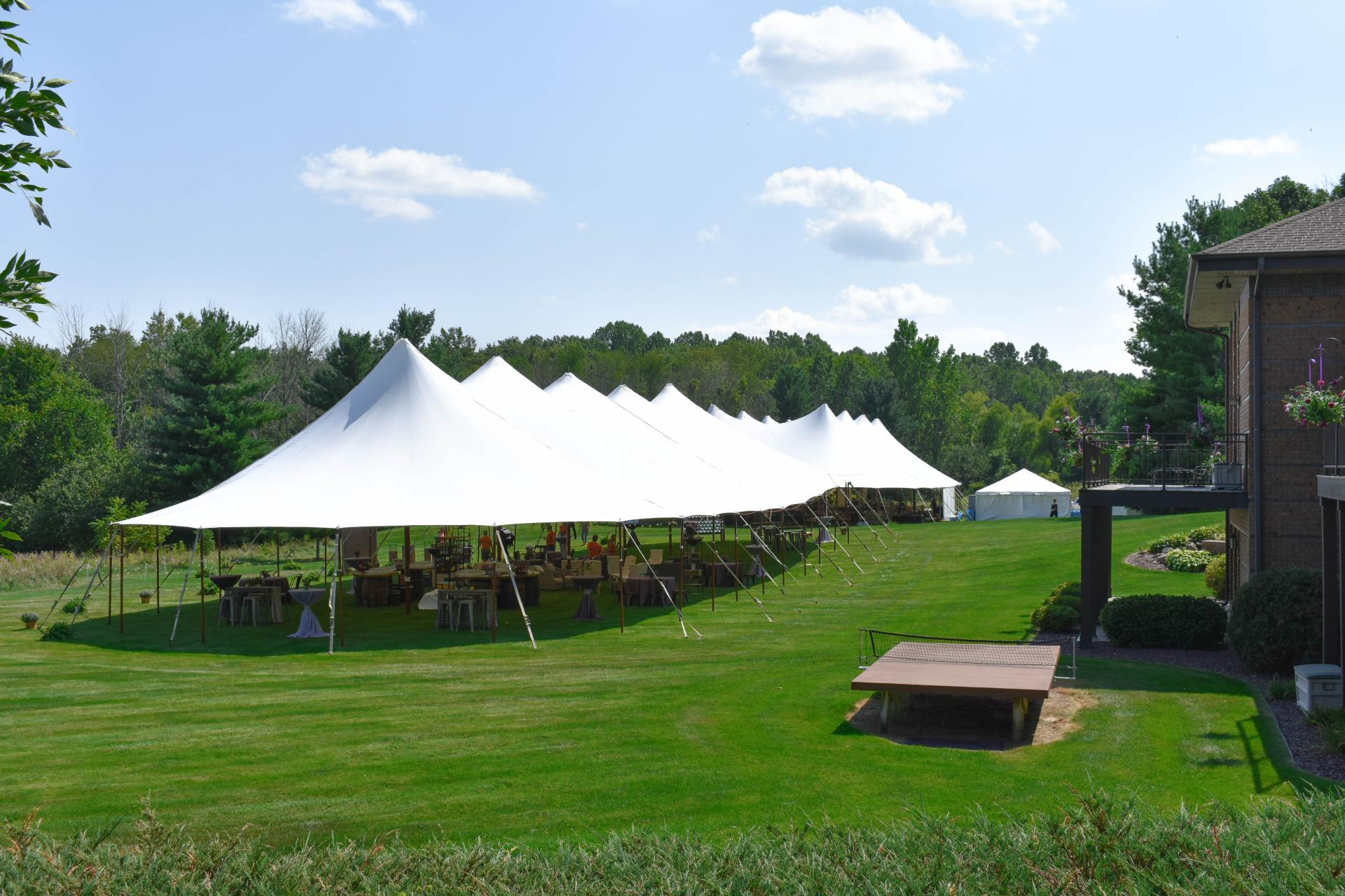 multiple sailcloth tents set for a wedding