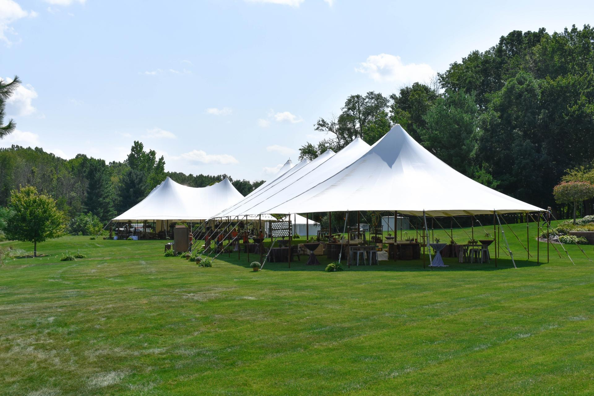 wedding with two sailcloth tents