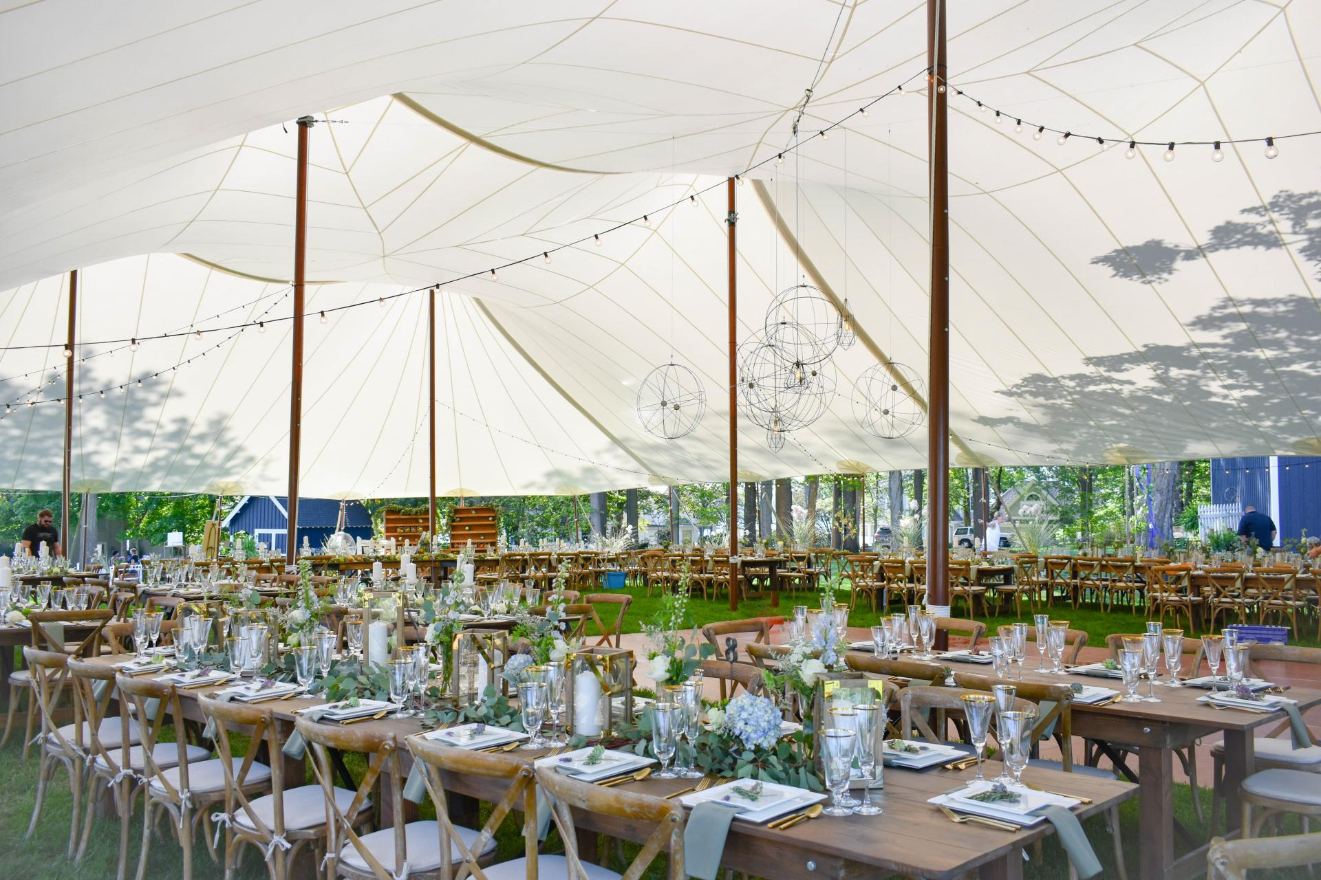 diamond lake wedding with sailcloth tent and pretty tables