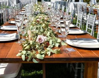 farm table and silver chiavari chair rental