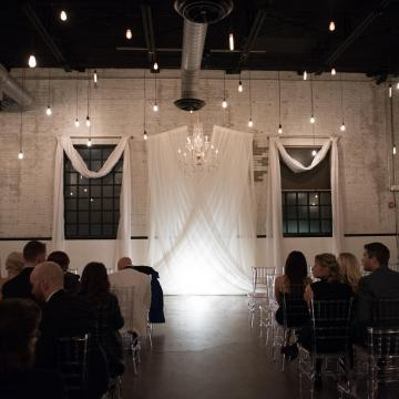 The Brick Drape Backdrop with Chandelier