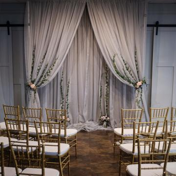 Ceremony Backdrop with Gold Chiavari Chairs